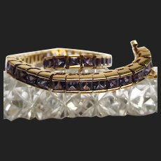 Divine 18K Gold Tanzanite Tennis Bracelet Channel Set Princess Cut 12.74 Carats
