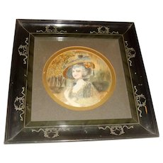 Antique silk embroidered picture of lady in circular frame