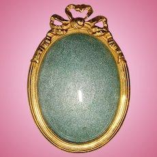 Miniature oval frame convex glass