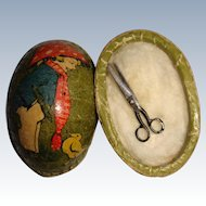 Miniature egg with tiny scissors