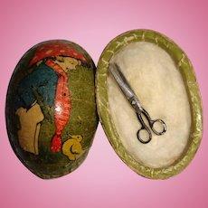 Miniature egg with tiny scissors