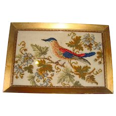 Early needlework picture of bird