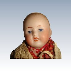 Cute boy bisque head small doll well dressed
