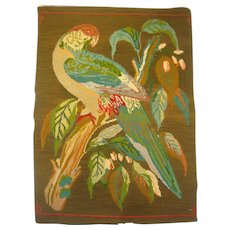 Antique needlework of parrot
