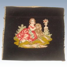 Antique needlework of a girl with dog