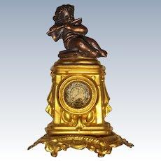 Ormolu mantle clock with cherub Erhard and Sohne
