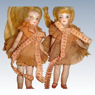 Cute pair of flapper dolls dressed in pink