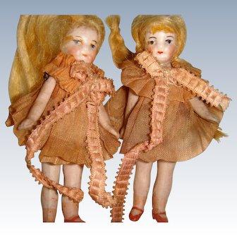 Cute pair of flapper dolls dressed in pink