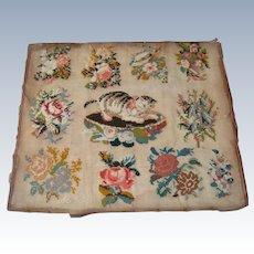 Needlework of cat on cushion with flower surround