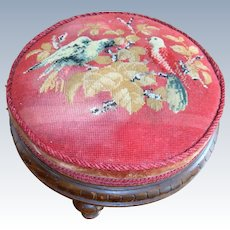 Bead work covered foot stool with birds