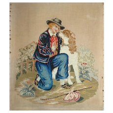 Charming needlepoint of boy with dog