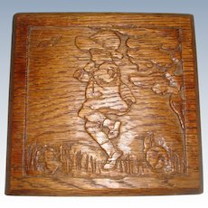 Hand carved small oak plaque of child