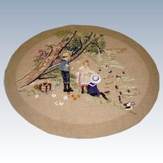 Delightful hand embroidered scene of  children on picnic