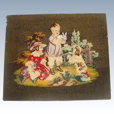 Sampler of children with rabbits and beadwork