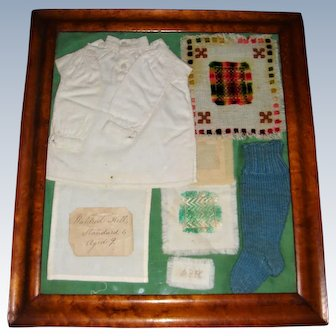 Sampler work by Mildred Kelly at Kirkwhelpington School with provenance