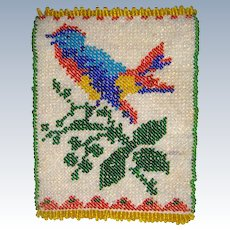 Small beadwork holder with bird