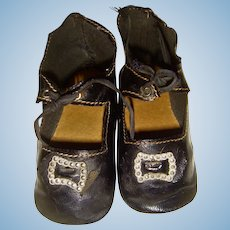 Pair old oil skin shoes with buckles