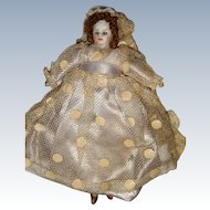Cute dolls house doll dressed as bride