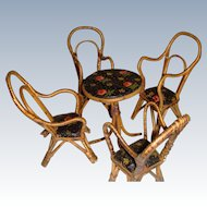 Set of cane table and chairs
