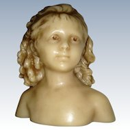 Poured wax bust of a child possibly French