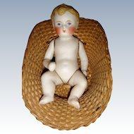All bisque baby boy in basket