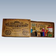 Tiny wooden scene in a matchbox