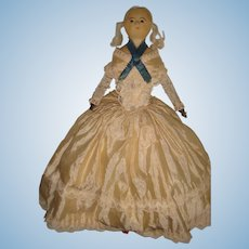 Slit head Wax doll in her original silk dress