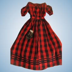 Unusual red and black dress with bag for large doll