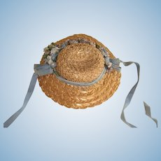 Small green flower trimmed straw hat for large doll