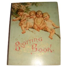 Old blotting book with babies