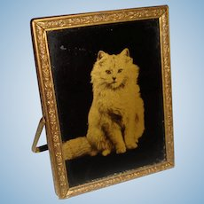 Miniature vintage mirror with cat on one side