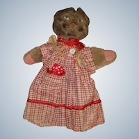 Adorable cat glove puppet in a dress