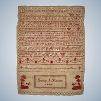 Neatly worked sampler by Emilly Hinton