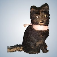 French black autometer cat which opens its mouth