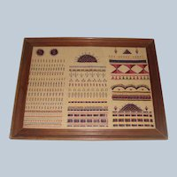 Very interesting sampler well worked with symbols