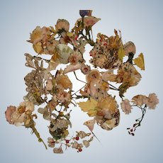 Collection of old silk flowers and decorative things for doll display