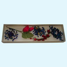 Collection of small old milliner's flower for doll display