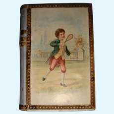 Charming early box boy playing tennis and mirror in lid