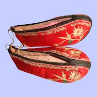 Pair of red silk embroidered Chinese childrens shoes