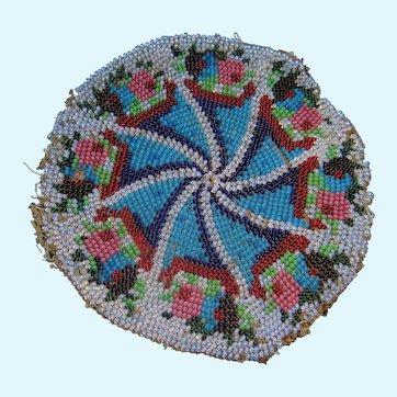 Pair of small circular bead work rugs
