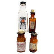 Four Pharmacy Bottles from Drugstore 3 Amber 1 Clear