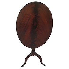 Oval Flame Mahogany Antique Tilt Top Table