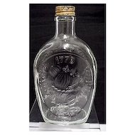 Log Cabin Syrup Commemorative Embossed Glass Bottle