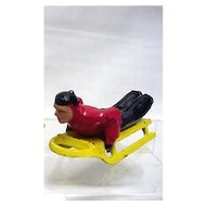 Toy Figurine Man on Sled  Miniature Winter Toy