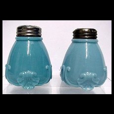 SOLD    See Others Available to purchase    Salt and Pepper Shakers Antique American Glass Footed Scroll Pattern