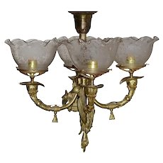 Four arm Victorian gas hanging light fixture with etched shades and animal/shield and musical instrument motif