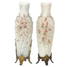 Pair of Wavecrest vases with a raised design.