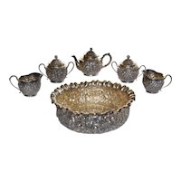 Sterling repousse six piece teaset in the manner of S. Kirk Baltimore