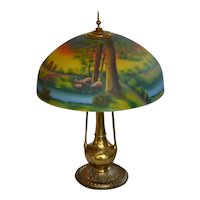 Reverse painted table lamp with scenic shade