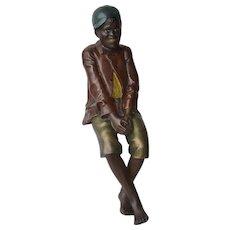 Sculpture of an African American boy